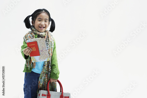 Girl holding large handbag and maps