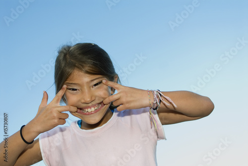 Girl making face outdoors