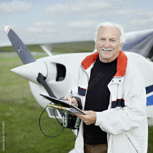 Man standing by a small airplane