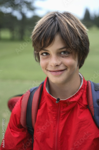 Boy outdoors with backpack