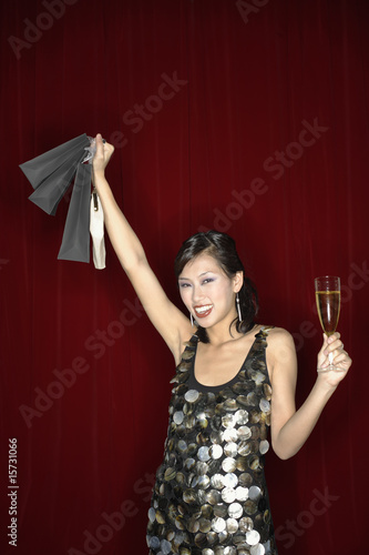Woman with champagne and bags