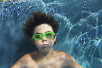 Boy wearing swim goggles underwater