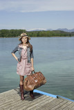 Woman on dock with large bag