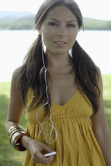 Woman with MP3 player outdoors