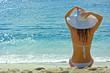 Brunette girl relaxing on the sea beach