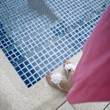 Woman's feet standing beside pool