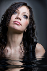 Glamour model with water reflection