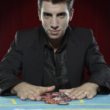 Man with betting chips on casino table