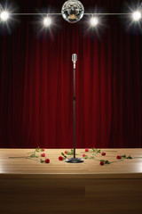 Microphone amongst roses on stage