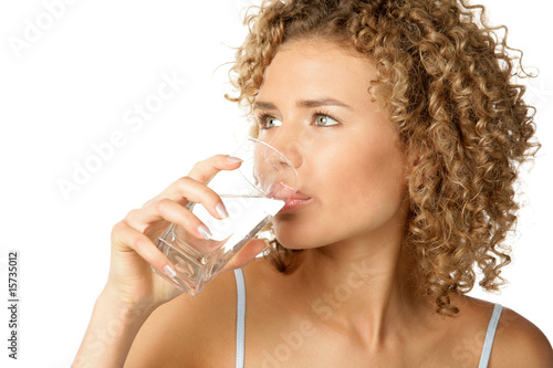 Leinwandbild Motiv Portrait of young woman drinking water