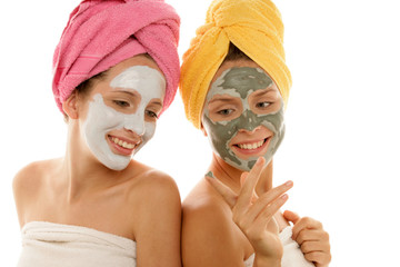 Two teenage girls wearing facial cream