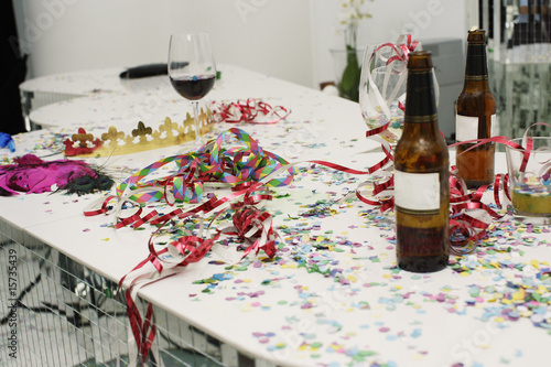 Table with drinks and confetti on it