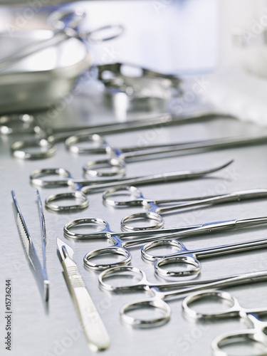 Medical scissors and scalpel on table