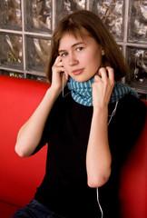 Girl in Blue Scarf Listening Music