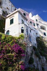 Houses on the cliff with flowers at the Amalfi coast