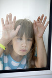 little girl play the fool looking through the window poster