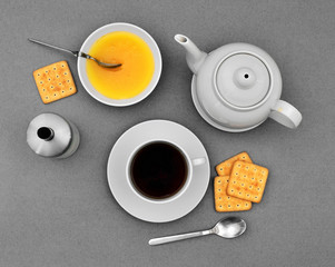 Teapot, cup, honey, sugar bowl and crackers (top)