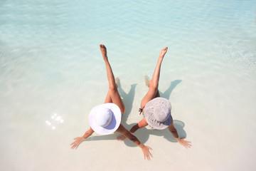 Woman lying in blue pool