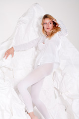 High fashion posing beautiful blond girl all in white