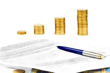 stack of coins and documents
