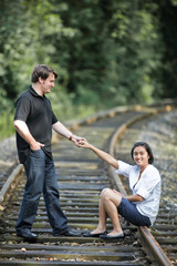 Couple playing on the rails