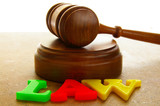 court gavel with colored play law letters poster