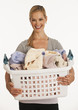 young woman holding laundry basket