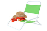 Beach items on green chair poster