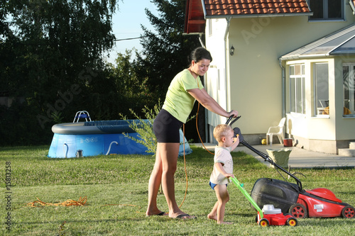Mother and child with lawn-mowers