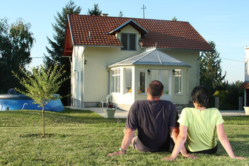 Couple in front of house 2