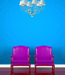 Two chairs  near  blue wall