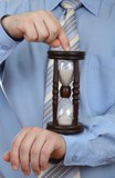 Businessman with hourglass - as