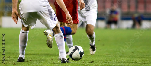 Soccer players fighting for the ball - 15833402
