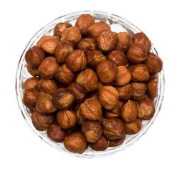 many hazelnuts isolated on white background
