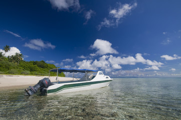 Tourist boat on crystal clear water