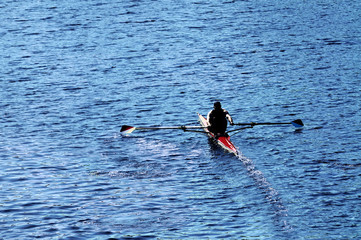 Young Man Rowing Boat