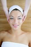 Head massage over bamboo, blue eyes woman