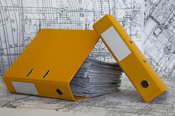 Heap of project drawings in yellow folder