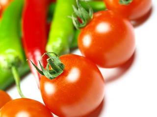 Red and green chilli peppers with cherrys tomatoes
