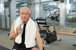 Man in gym with towel drinking