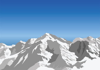 Snow capped mountain against a blue sky