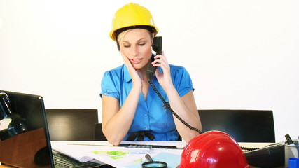 Architect woman talking on phone in office footage