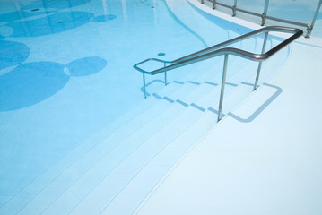 pool entrance with hand rails