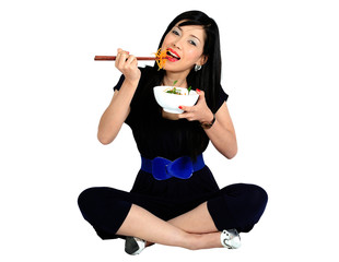 Young asian girl eating salad