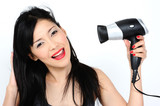 young asian woman with hair-dryer poster