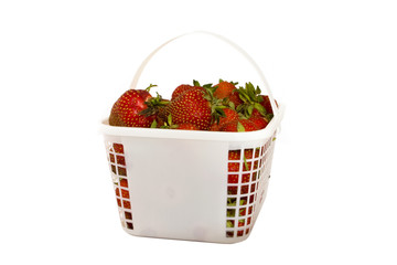 Strawberries in a basket set against a white background
