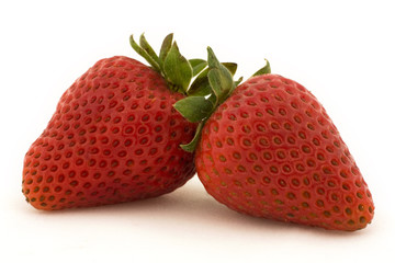 Two strawberries set against a white background