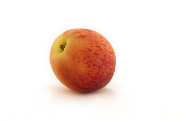 Nectarine set against a white background