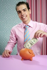 Businessman with piggy bank dollar note