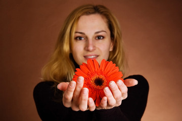 Young blonde with a red flower